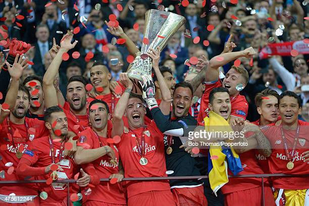 Fernando Navarro of Sevilla holds aloft the trophy as the team celebrate victory after the UEFA Europa League Final match between FC Dnipro...