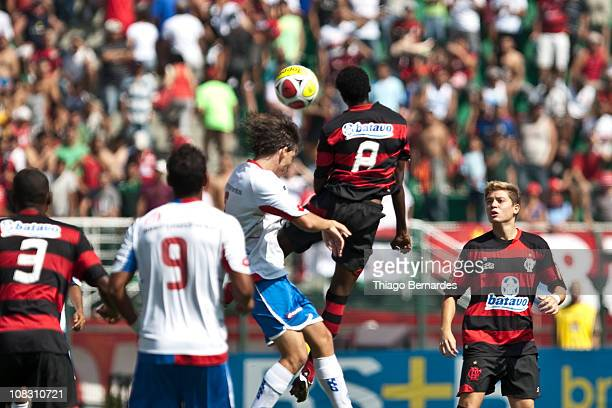 Fernando of Bahia struggles for the ball with Negueba of Flamengo during the final match of Sao Paulo Juniors Cup 2011 at Pacaembu Stadium on January...
