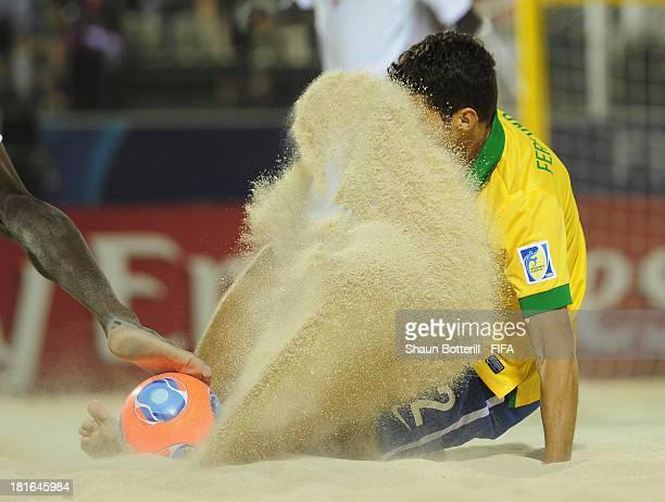 Fernando of Brazil challenges for the ball during the FIFA Beach Soccer World Cup Tahiti 2013 Group C match between Brazil and Senegal at the Tahua...
