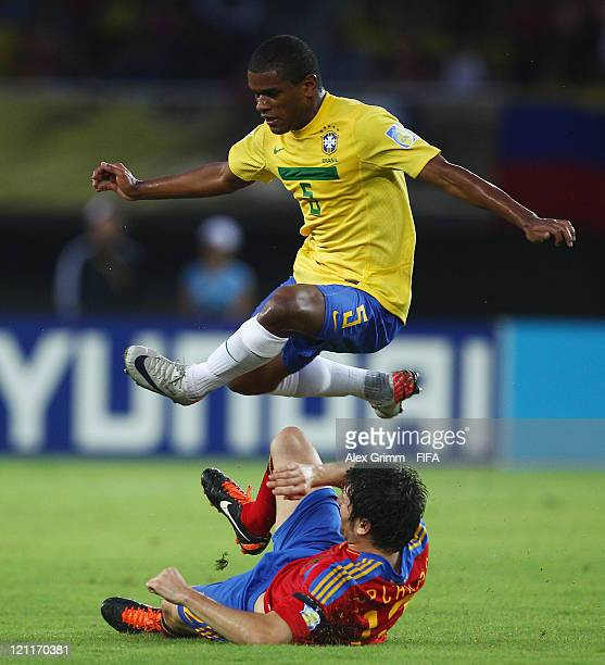 Fernando of Brazil is challenged by Carles Planas of Spain during the FIFA U20 World Cup 2011 quarter final match between Brazil and Spain at Estadio...