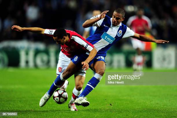 Fernando of FC Porto and Theo Walcott of Arsenal battle for the ball during the UEFA Champions League last 16 first leg match between FC Porto and...