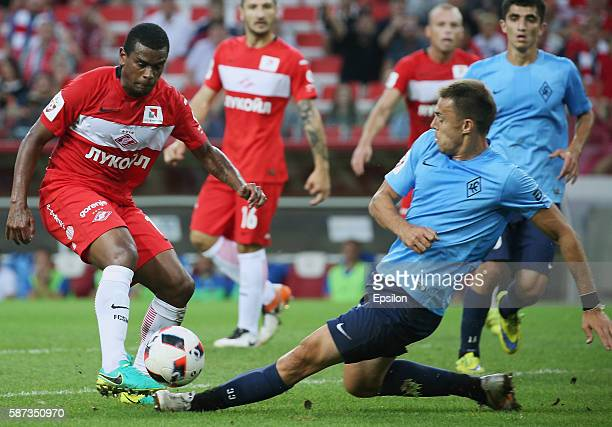 Fernando of FC Spartak Moscow challenged by Milan Rodic of FC Krylia Sovetov Samara during the Russian Premier League match between FC Spartak Moscow...