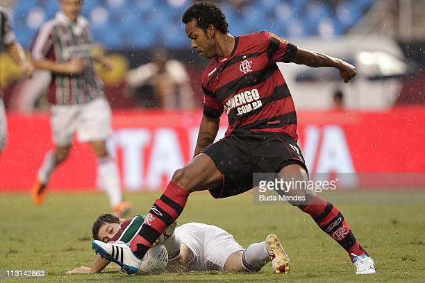 Fernando of Flamengo struggles for the ball with Conca of Fluminense during a match as part Semifinal of Rio de Janeiro State Championship 2011 at...