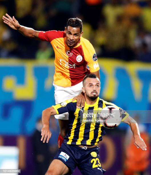 Fernando of Galatasaray in action against Ilhan Parlak of Ankaragucu during Turkish Super Lig's new season's debut match between MKE Ankaragucu and...