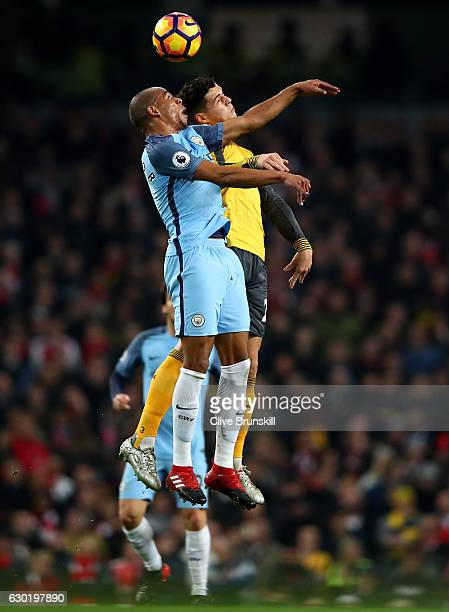 Fernando of Manchester City and Alexis Sanchez of Arsenal battle to win a header during the Premier League match between Manchester City and Arsenal...