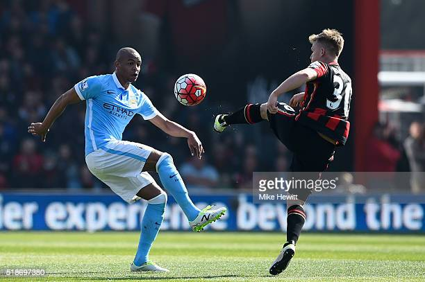 Fernando of Manchester City and Matt Ritchie of Bournemouth compete for the ball during the Barclays Premier League match between AFC Bournemouth and...