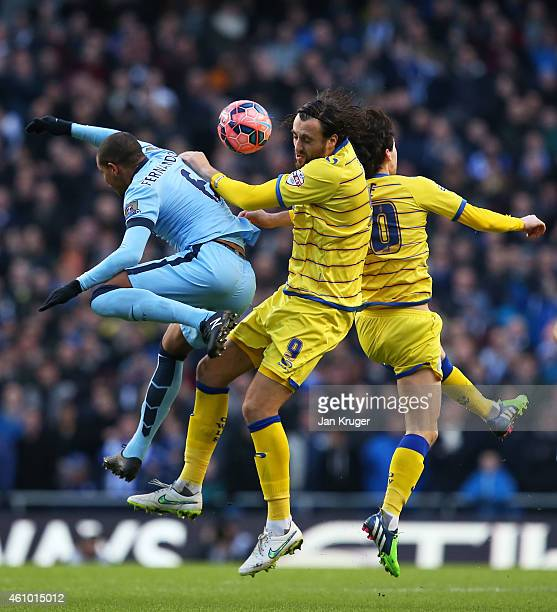 Fernando of Manchester City Atdhe Nuhiu of Sheffield Wednesday and Kieran Lee of Sheffield Wednesday compete for a header during the FA Cup Third...