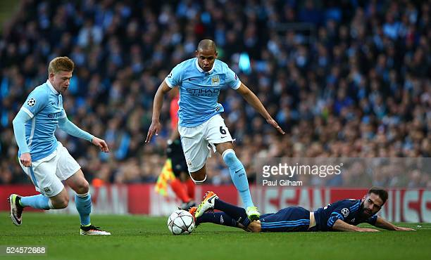 Fernando of Manchester City goes apst the challenge from Daniel Carvajal of Real Madrid CF during the UEFA Champions League Semi Final first leg...
