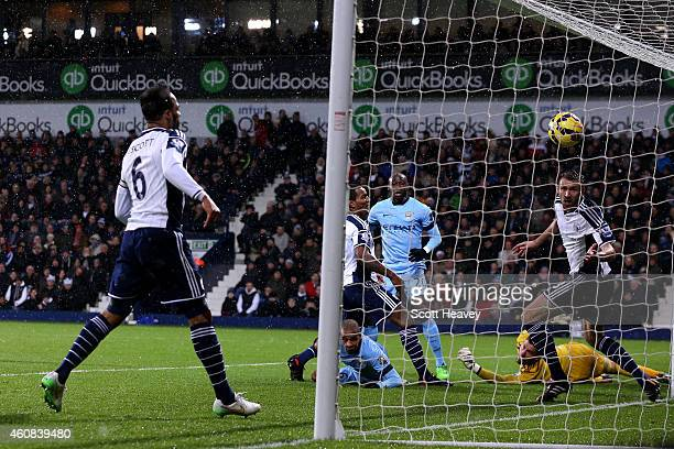 Fernando of Manchester City scores the opening goal during the Barclays Premier League match between West Bromwich Albion and Manchester City at The...