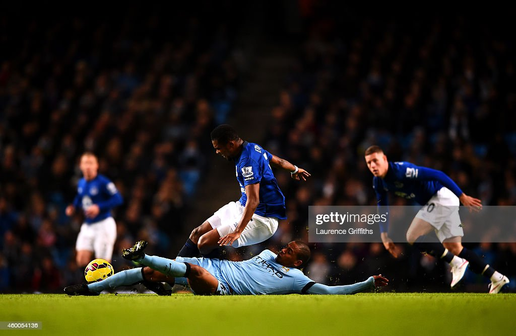 Fernando of Manchester City slides in on Samuel Eto'o of Everton during the Barclays Premier League match between Manchester City and Everton at Etihad Stadium on December 6, 2014 in Manchester, England.