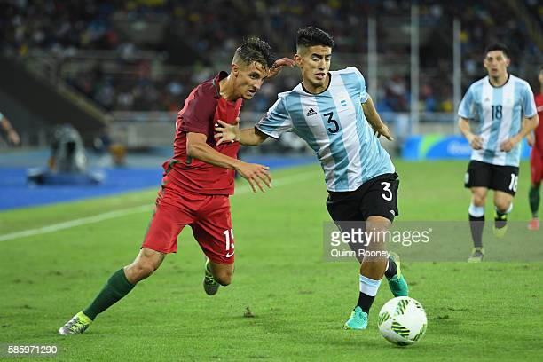 Fernando of Portugal controls the ball under pressure from Alexis Soto of Argentina during the Men's Group D first round match between Portugal and...