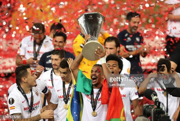 Fernando of Sevilla celebrates with the UEFA Europa League Trophy following his team's victory in the UEFA Europa League Final between Seville and FC...