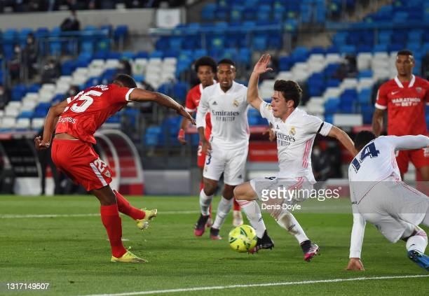 Fernando of Sevilla scores their side's first goal during the La Liga Santander match between Real Madrid and Sevilla FC at Estadio Alfredo Di...