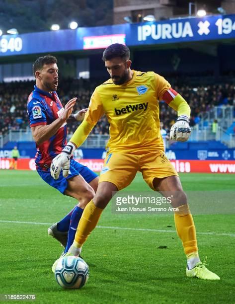 Fernando Pacheco of Deportivo Alaves duels for the ball with Sergi Enrich of SD Eibar during the Liga match between SD Eibar SAD and Deportivo Alaves...