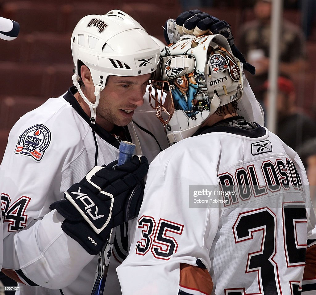 Fernando Pisani #34 congratulates teammate Dwayne Roloson #35 of the Edmonton Oilers for a win against the Anaheim Ducks during the game on March 27, 2009 at Honda Center in Anaheim, California.