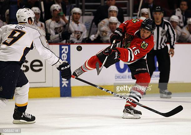 Fernando Pisani of the Chicago Blackhawks shoots the puck past Marcel Goc of the Nashville Predators at the United Center on October 13 2010 in...