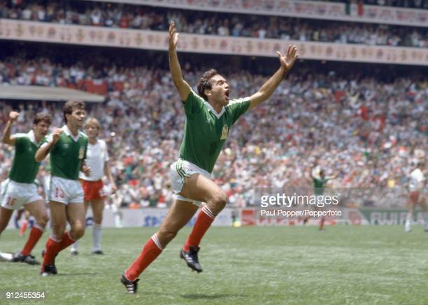 Fernando Quirarte celebrates after scoring the first goal for Mexico during the FIFA World Cup match between Belgium and Mexico at the Estadio Azteca...