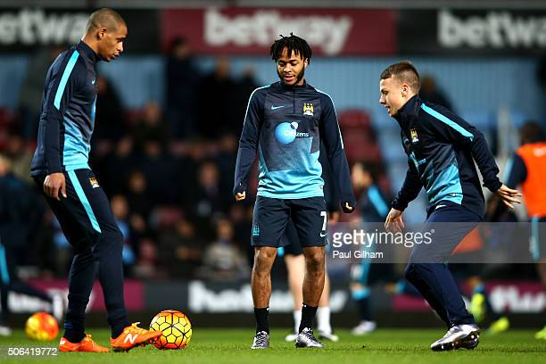 Fernando Raheem Sterling and Jose Angel Esmoris Tasend of Manchester City warm up prior to the Barclays Premier League match between West Ham United...