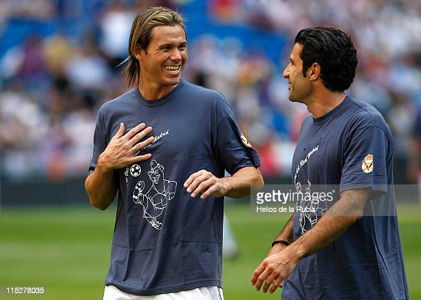 Fernando Redondo and Luis Figo of Real Madrid chats before of the Corazon Classic Match between Allstars Real Madrid and Allstars Bayern Muenchen at...