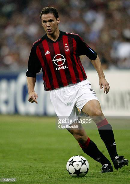 Fernando Redondo of AC Milan runs with the ball during the UEFA Champions League SemiFinal First Leg match between AC Milan and Internazionale Milano...