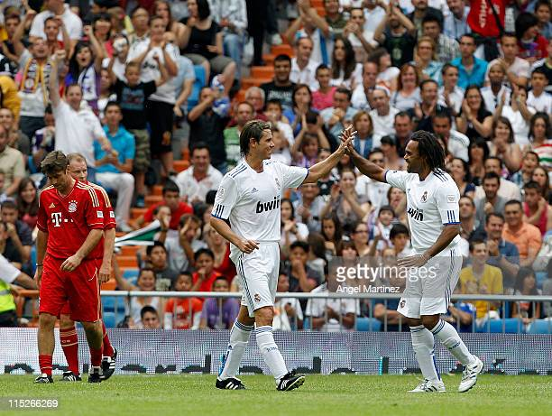 Fernando Redondo of Real Madrid celebrates with Christian Karembeu after scoring during the Corazon Classic Match between Allstars Real Madrid and...