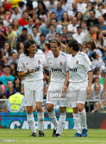 Fernando Redondo of Real Madrid celebrates with Emilio Amavisca and Aitor Karanka after scoring during the Corazon Classic Match between Allstars...