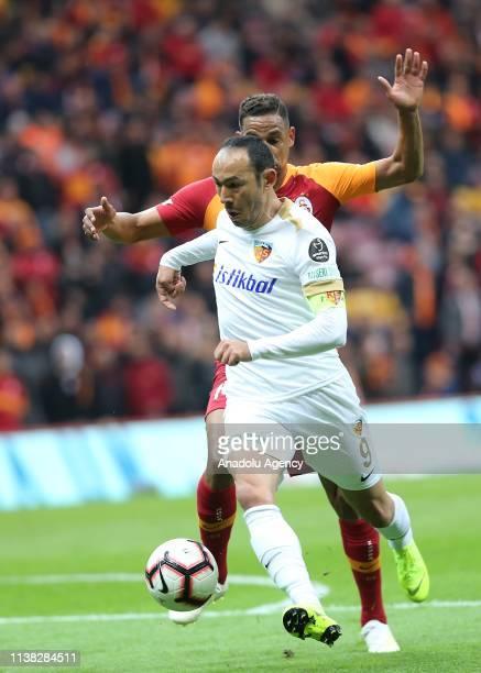 Fernando Reges of Galatasaray vies with Umut Bulut of Istikbal Mobilya Kayserispor during Turkish Super Lig soccer match between Galatasaray and...
