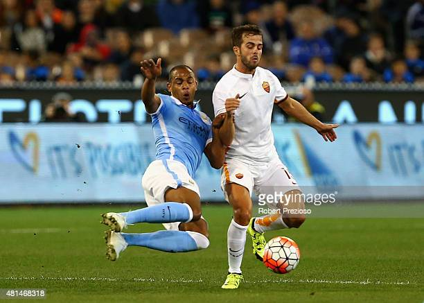 Fernando Reges of Manchester City and Miralem Pjanic of AS Roma contest the ball during the International Champions Cup friendly match between...