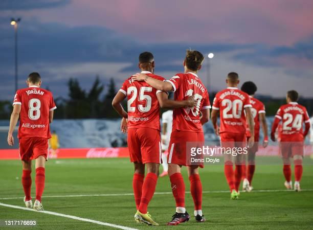 Fernando Reges of Sevilla FC celebrates with team mate Ivan Rakitic after scoring their team's opening goal during the La Liga Santander match...