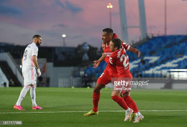 Fernando Reges of Sevilla FC celebrates with team mate Papu Gomez after scoring their team's opening goal during the La Liga Santander match between...