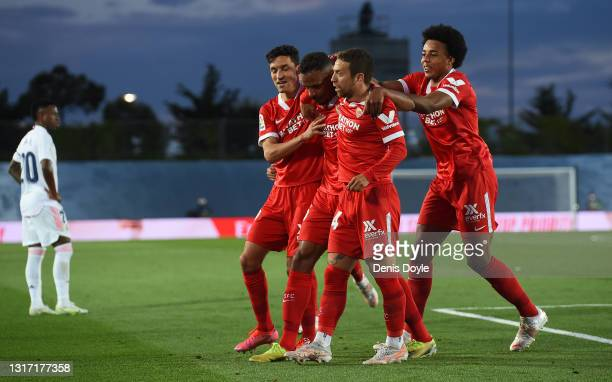 Fernando Reges of Sevilla FC celebrates with team mates after scoring their team's opening goal during the La Liga Santander match between Real...
