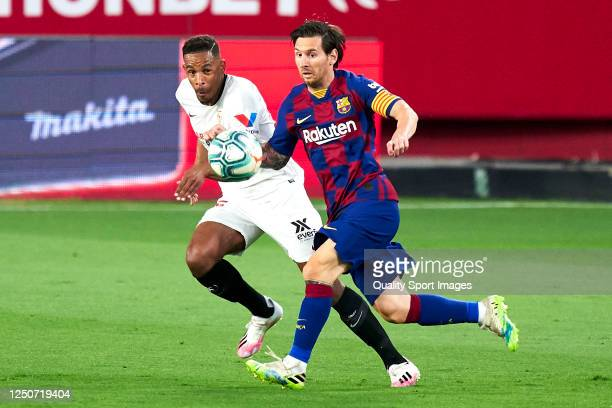 Fernando Reges of Sevilla FC competes for the ball with Lionel Messi of FC Barcelona during the Liga match between Sevilla FC and FC Barcelona at...