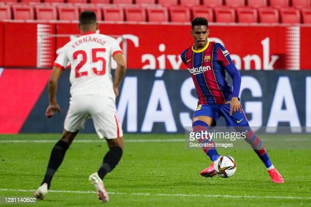 Fernando Reges of Sevilla FC, Junior Firpo of FC Barcelona during the Spanish Copa del Rey match between Sevilla v FC Barcelona at the Estadio Ramon...
