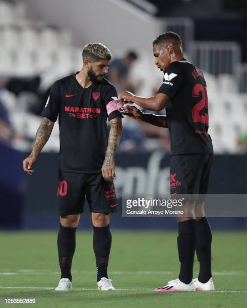 Fernando Reges of Sevilla FC puts the captain´s armband to his teammate Ever Banega during the Liga match between CD Leganes and Sevilla FC at...