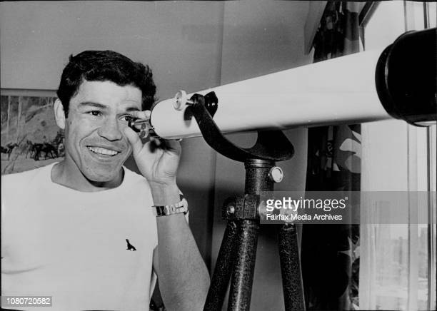Fernando relaxes in his room at a King's X motel watching the view from his window with a telescopeMexican boxer Fernando Sotelo who meets aboriginal...