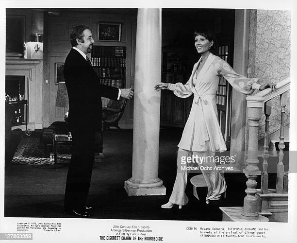 Fernando Rey is greeted bravely by Stephane Audran after he arrives 24 hours early in a scene from the film 'The Discreet Charm of The Bourgeoisie'...