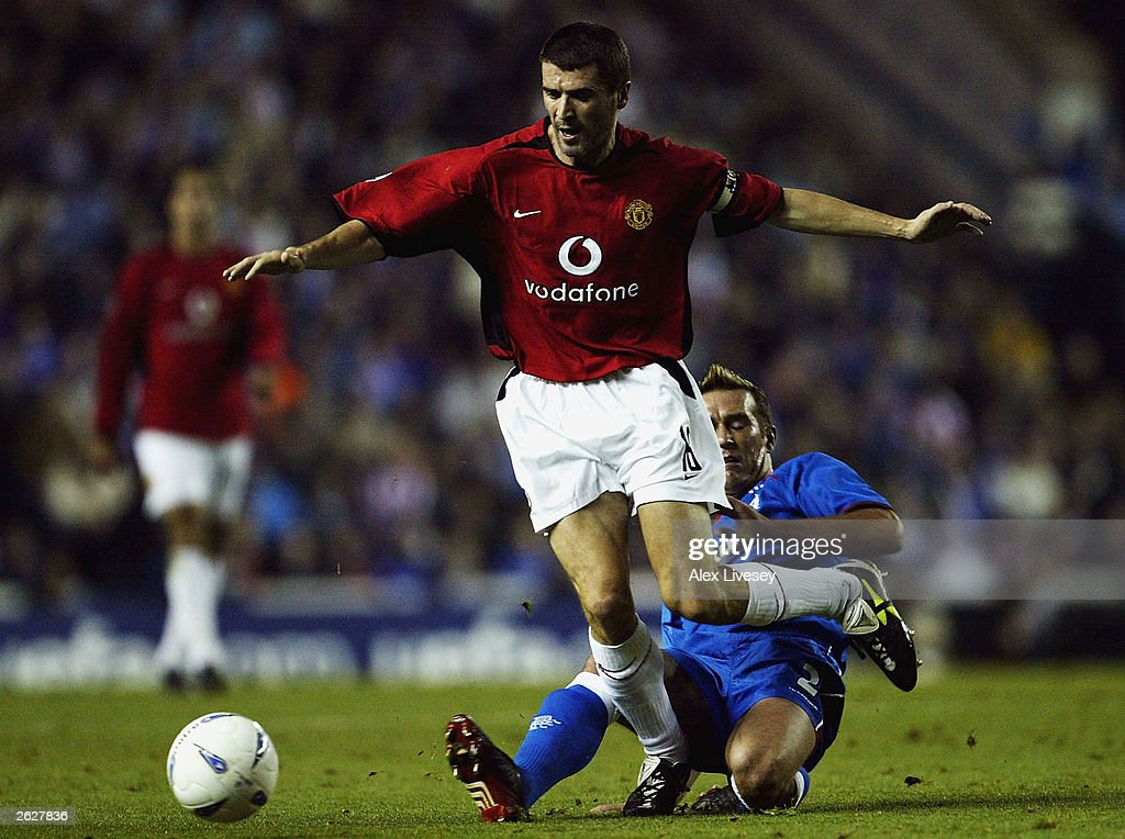 Fernando Ricksen of Rangers clashes with Roy Keane of Man Utd during the UEFA Champions League, Group E match between Glasgow Rangers and Manchester United at Ibrox on October 22, 2003 in Glasgow, Scotland.