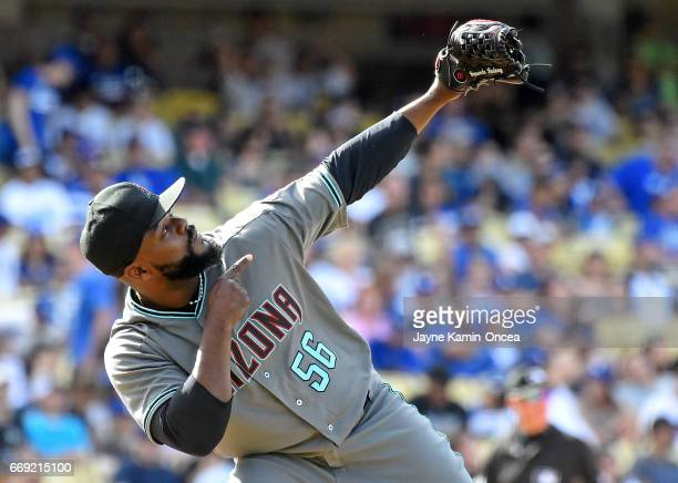 Fernando Rodney of the Arizona Diamondbacks gestures to the sky after earning a save in the ninth inning of the game against the Los Angeles Dodgers...