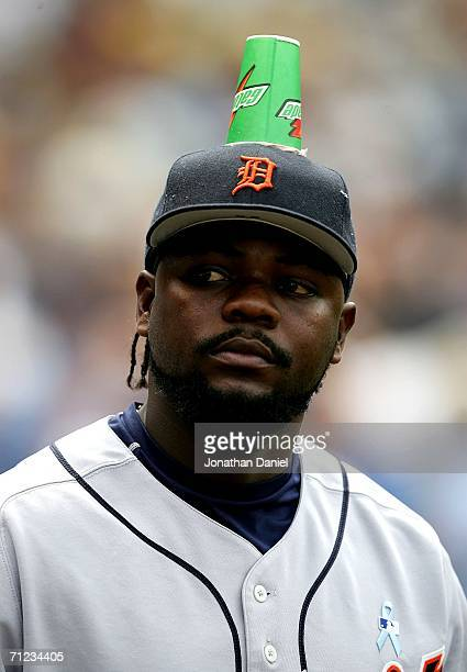 Fernando Rodney of the Detroit Tigers a victim of a prank by teammates walks to the bullpen with a cup attached to his head with chewing gum during a...