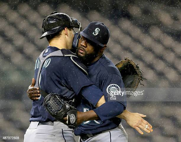 Fernando Rodney of the Seattle Mariners celebrates the win with teammate Mike Zunino after the game against the New York Yankees on April 29 2014 at...