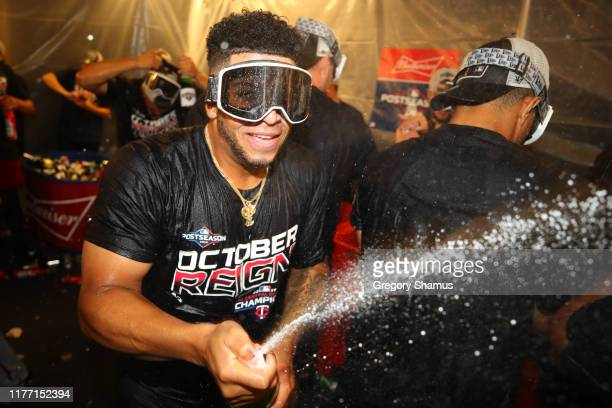 Fernando Romero of the Minnesota Twins celebrates winning the American League Central Division title after a 51 win against the Detroit Tigers and a...