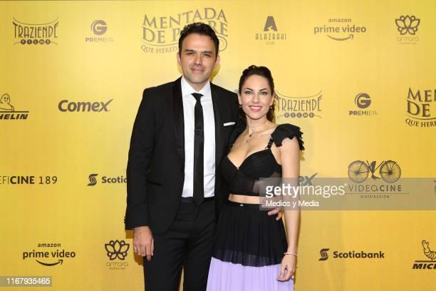 Fernando Rovzar and Barbara Mori pose for photos as part of the red carpet 'Mentada de Padre' at Cinemax Antara on August 13 2019 in Mexico City...