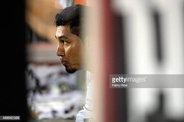Fernando Salas of the Los Angeles Angels looks on in the dugout after giving up a solo home run to Mike Moustakas of the Kansas City Royals in the...