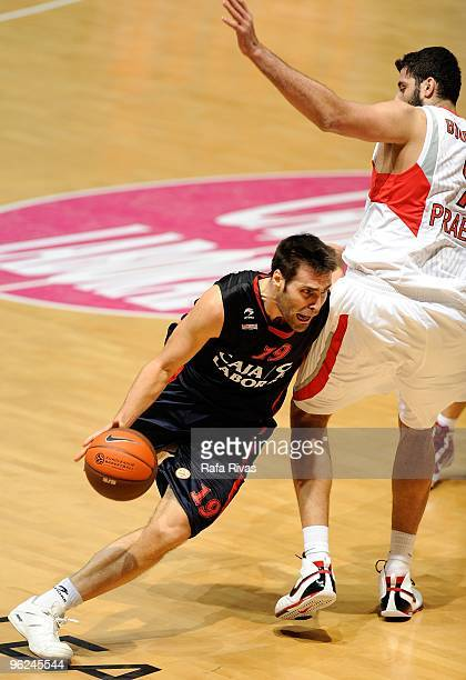 Fernando San Emeterio #19 of Caja Laboral competes with Ioannis Bourousis #9 of Olympiacos Piraeus during the Euroleague Basketball 20092010 Last 16...