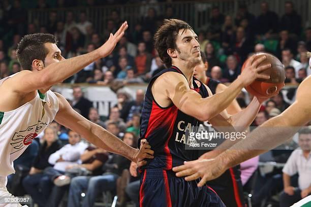 Fernando San Emeterio #19 of Caja Laboral competes with Sani Becirovic #7 of Union Olimpija during the Euroleague Basketball Regular Season 20092010...