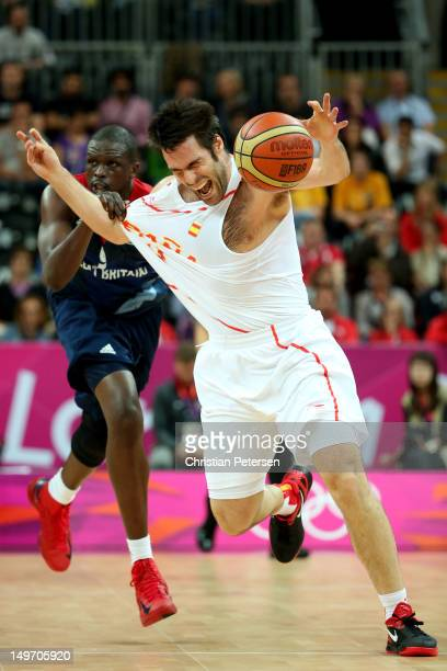 Fernando San Emeterio of Spain loses control of the ball against Luol Deng of Great Britain in the first half during the Men's Basketball Preliminary...