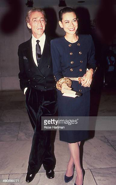 Fernando Sanchez and Tina Chow attend an exhibit at the Fashion Institute of Technology New York New York 1984