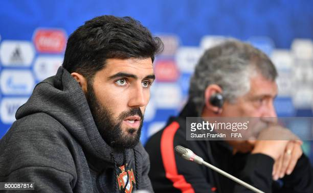 Fernando Santos head coach of Portugal looks on as Luis Neto talks to the media during a press conference of the Portugal national football team on...