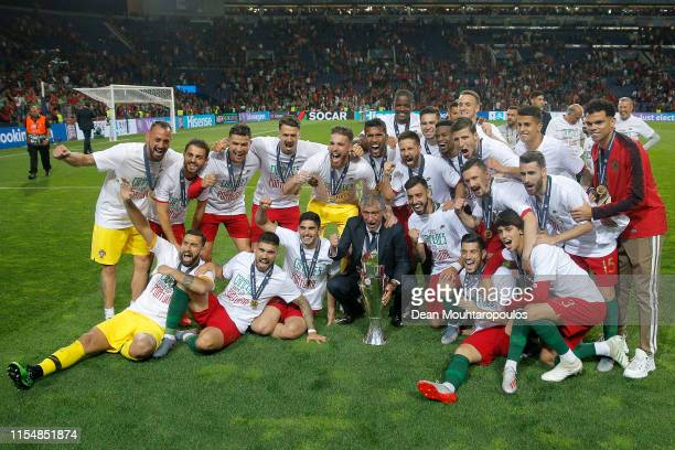 Fernando Santos manager of Portugal and his team celebrate with the UEFA Nations League Trophy following their victory in the UEFA Nations League...