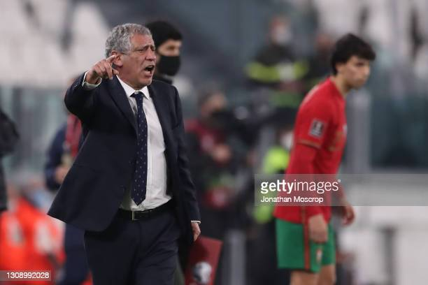 Fernando Santos manager of Portugal gives directions as Joao Felix of Portugal waits to enter the field of play as a second half substitute during...